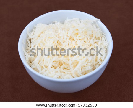 one small white prep bowl full of shredded cheese ready to cook.
