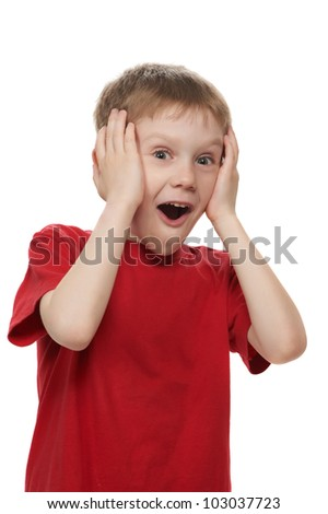 One smiling boy open-mouthed with surprise isolated on white