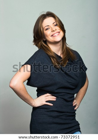One smiling woman on gray background