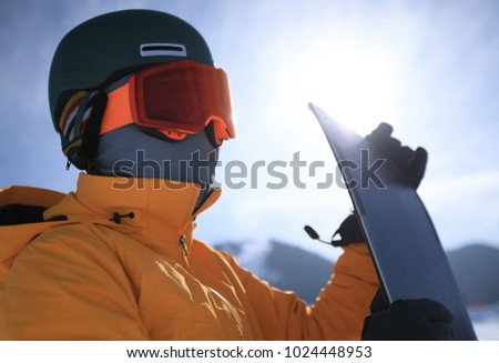 one snowboarder with snowboard in winter mountains #1024448953