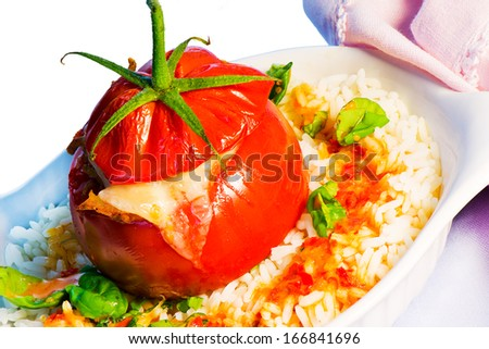 One stuffed tomato on a white plate