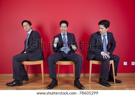 One successful businessman between two jealous businessman