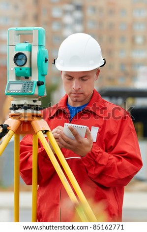 One surveyor worker with theodolite equipment outdoors input the data
