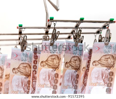 one thousand baht thai bank notes in hanging mood