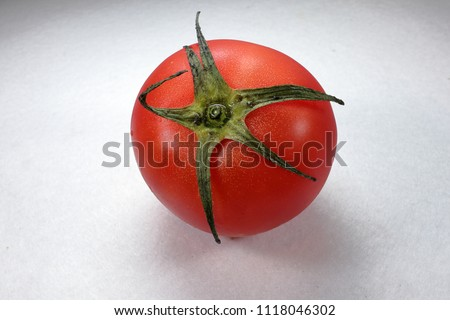 Stock Photo one tomato on white background