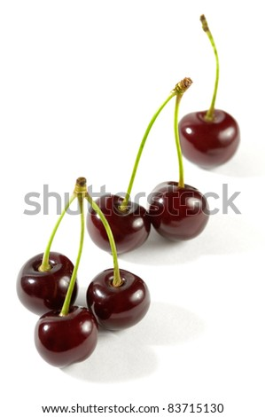 One Two and Three cherries close-up Isolated over white background