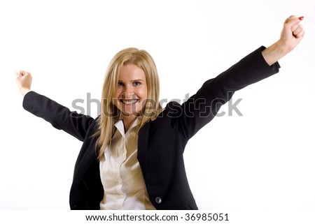 One very happy businesswoman with her arms raised