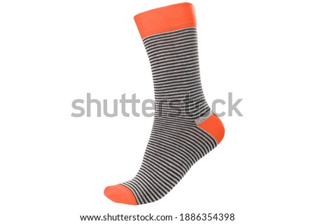 One volumetric sock with different lines isolated on white background. Colorful volumetric sock son white background. Colored socks on the leg isolated on white background