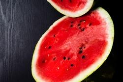One watermelon cut in halves isolated on black background with clipping path