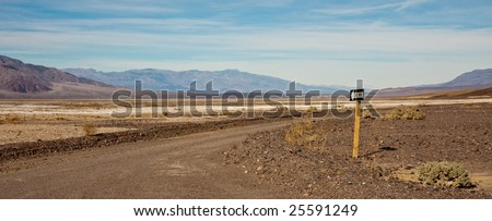One Way Road Panorama in Death Valley - stock photo