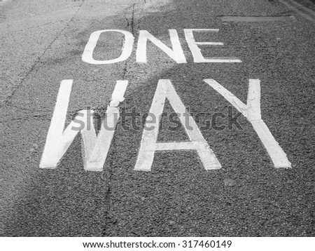 One way sign in the street in black and white #317460149