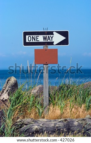 One way sign with empty box on the beach