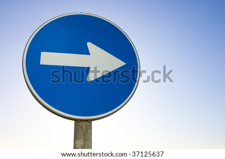 one way signal with blue sky