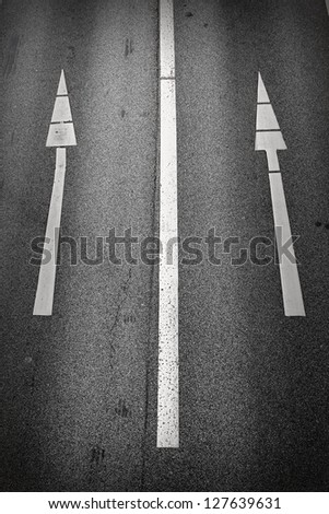 One-way signs on a road/Straight On
