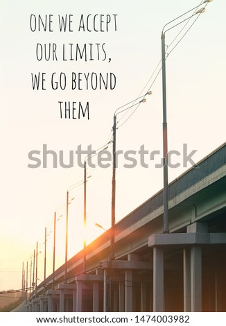 one we accept our limits, we go beyond them - Inspiration motivation quote about happy life. sunset or sunrise, sky and big bridge, industrial buildings. industrial landscape.