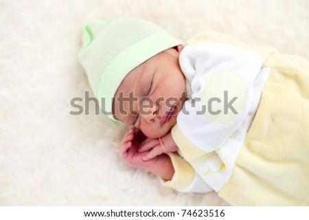 One week old baby boy asleep