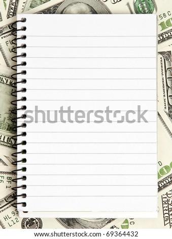 One white notepad on dollars background