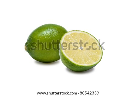 One whole lime with half lime isolated on white background