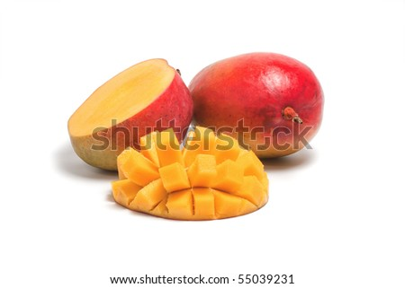 One whole ripe mango and a sliced half of a mango isolated on white background