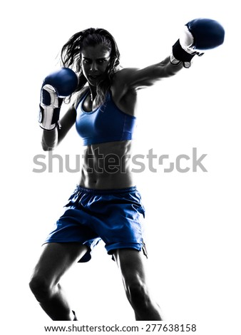Stock Photo one woman boxer boxing kickboxing in silhouette isolated on white background