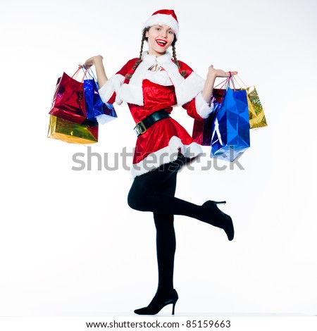 one woman dressed as santa claus carrying christmas bags  on studio isolated white background