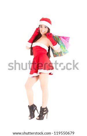 one woman dressed as santa claus holding christmas presents gifts on the telephone studio isolated white background