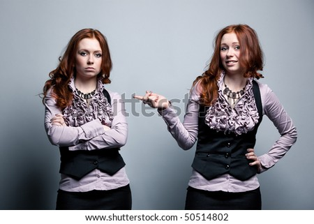 One woman with two emotion moods. - stock photo