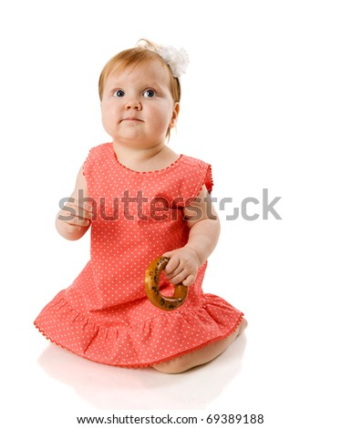 One year Baby eating tasty cookie isolated on white