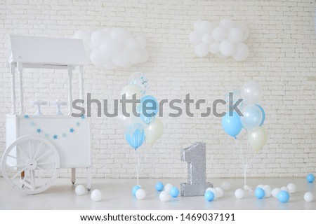 One year birthday decorations. Decorations for holiday party.  A lot of balloons blue and white colors.