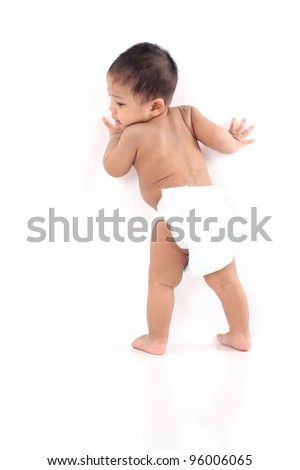 One year old asian baby walking isolated with large copy-space