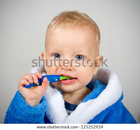 One year old baby boy with tooth brush