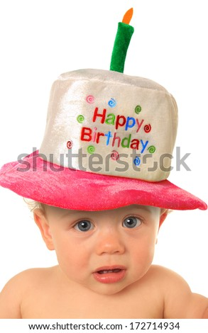 One year old baby girl with Happy Birthday hat.