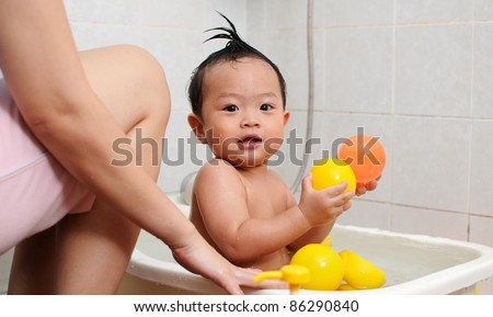 one year old baby is taking a bath stock photo 86290840 shutterstock. Black Bedroom Furniture Sets. Home Design Ideas