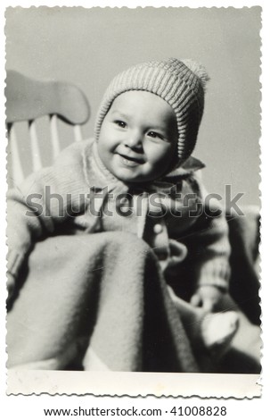 One year old boy sitting and posing in the studio; old photo taken in 1974