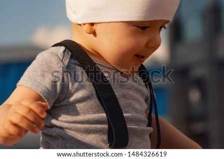 One year old child on the street. Walk in an urban environment. The concept of urbanization and life in the city