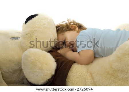 One year old girl playing with giant plush dog