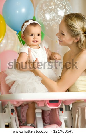 one-year-old little girl with  mammy, happy family, vertical photo