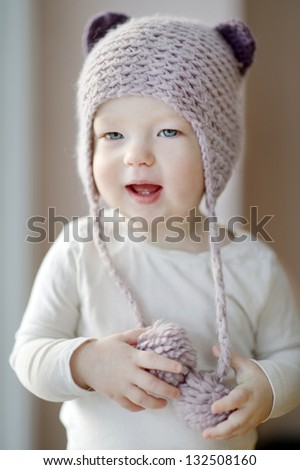 One year old toddler girl in funny hat