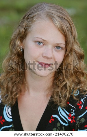 stock photo : one young blonde teen model posing outdoors closeup portrait