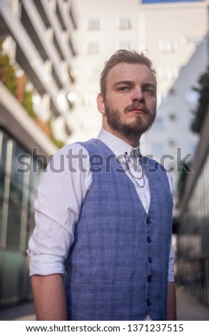 one young businessman, seriously looking to camera, looking to camera. #1371237515