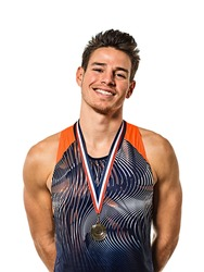 one young caucasian man athetle gold medalist athletics in studio isolated on white background