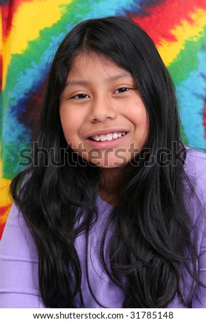 one young ethnic mayan girl with long black hair over a very colorful background - stock photo