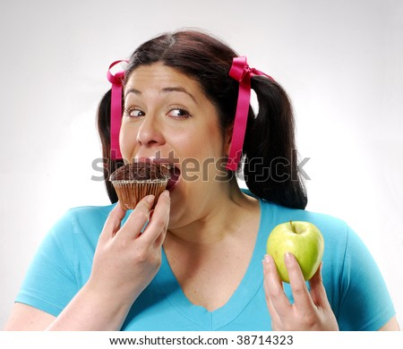 http://image.shutterstock.com/display_pic_with_logo/258064/258064,1255175553,7/stock-photo-one-young-fat-woman-holding-a-chocolate-cake-and-apple-young-woman-eating-a-chocolate-snack-cake-38714323.jpg
