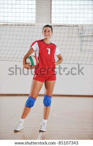 one young girl playing volleyball game sport  indoor