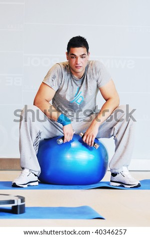one young healthy man exercise fitness recreation and yoga indoor