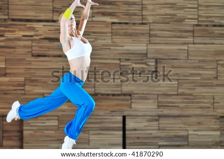 one young healthy woman exercice fitness recreation and yoga indoor
