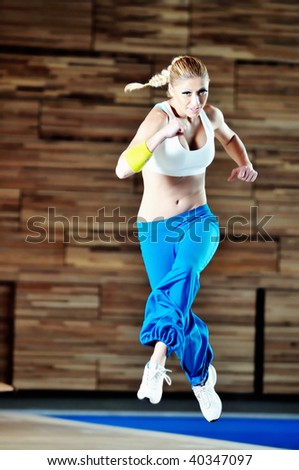 one young healthy woman exercise fitness recreation and yoga indoor