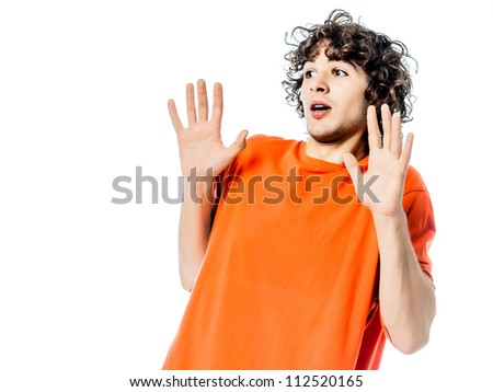 one young man caucasian gesturing  surprised fear afraid portrait  in studio white background