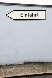 Oneway sign on a street corner
