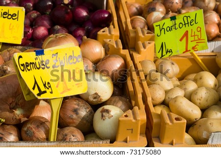 Onion and potato with EUR prices on German vegetable market